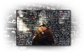 A couple kiss in front of the wall I love you Paris.